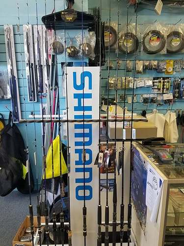 assorted fishing poles